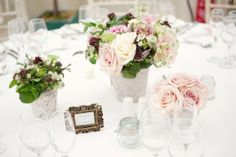 We chose vintage roses in muted peach and pink with lots of natural loose flowers and rosemary and flowering mint