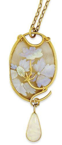 Lalique - 1900 signed Opal & Glass Gold-Mounted Pendant. The carved opal flowers & foliage applied to a textured opalescent glass ground w/in a sinuous gold frame, suspending a pear-shaped opal drop to an oval link chain w/ two further opal bead accents, pendant 9 cm long | christies.com