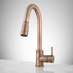 Buy the Signature Hardware 369598 Antique Copper Direct. Shop for the Signature Hardware 369598 Antique Copper Finite Kitchen Faucet with Swivel Spout and Pull-Down Spray and save. Copper Kitchen Faucets, Copper Faucet, Bathroom Faucets, Bathrooms, Kitchen Hardware, Martha Stewart, Bronze, Kitchen And Bath, Houses