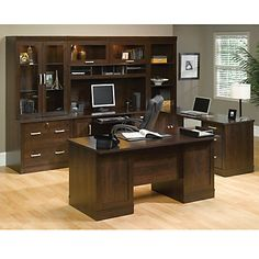 The Office Port Executive Desk makes an excellent centerpiece for any office. Set includes an executive desk, credenza with hutch, lateral file with hutch, and library desk!
