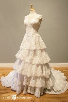 Tiered Lace Wedding Dress Ball Gown - Grace Style - Avail & Company, LLC  Fairy Tale Vintage Ruffled Dress with Lace and a V Back. Lace Bodice with a Sweetheart neckline, illusion straps and a drop waist. The skirts is tiered with ruffled Alencon lace that drops into a chapel train. Perfect for Autumn.