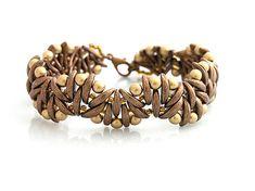 Crescent beads bracelet  http://www.sashe.sk/kacenkag/detail/mesiacikovy-vlnka-hnedo-zlata