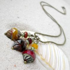 this is an autumn colored triple bead pendant necklace it is full of beautiful
