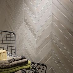 Highlight your space with an eye-catching focal wall. Use wood-look tile in a chevron pattern for added interest.