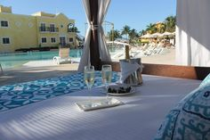 The ultimate relaxing afternoon: chilled champagne and a private bali bed by the pool at Secrets Capri Riviera Cancun!
