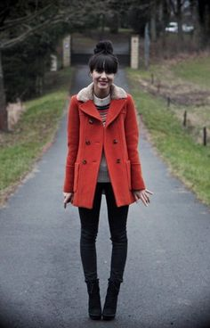❤ Red peacoat with a faux fur collar, multi colored grey seater, black skinny jeans, black booties