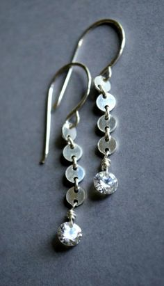 Tiny sterling silver sequin and cz earrings. From Kahili Creations of Hawaii...
