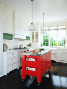 A roll-away tomato-red island is one way to inject luscious color without committing to an all-red kitchen. Red Kitchen Island, Kitchen Dining, Kitchen Cabinets, Chefs, Kitchen Cabinet Accessories, Home Chef, Cuisines Design, Kitchen Colors, Beautiful Kitchens