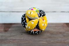 A personal favorite from my Etsy shop https://www.etsy.com/listing/400163875/amish-fabric-puzzle-ball-black-yellow