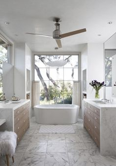 Traditional meets modern in this gorgeous open floor plan bathroom.