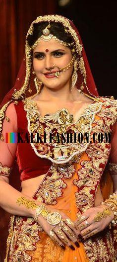 Zareen Khan walks in a red and orange lehenga for Swarovski at India International Jewellery week 2014. http://www.kalkifashion.com/