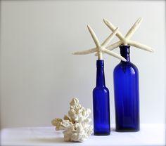 deep blue bottles... gorgeous colour. at coastal vintage