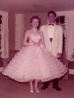 "Betsey Johnson, Terryville High School, Terryville, Connecticut, 1958. ""I was queen of my senior prom. I probably only won because I was on the prom committee. I wore hoops and petticoats to make sure my princess gown stuck straight out—it had to be big, big, beyond bouffant big!"""