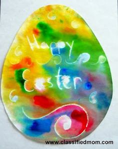 Cut out egg, decorate with white crayon, add drops of food coloring, spray with water, let dry.