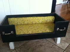 Dog bed i made from a drawer,cut a spot for leaping in nice cushiony bed i upholstered and painted then distressed.i added a few drawer pulls so you would realize what it originally was.love!!