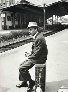 The Chairman of the Board. (Sinatra waiting for a train? You'd think they would just know not to make him wait...)
