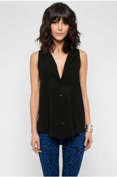 Sleeveless black Button Down Shirt w/ blue skinny jean... Love the shoulder length hair with thick bangs- hair  Check out this website