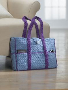 Eight-pocket two-tone carryall tote..found on lionbrand.com