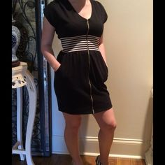Black Casual DressFrom Local Boutique Super cute and chic black casual dress that can be worn to any function. Front zipper, white and black banding under bodice and side pockets make this dress stand out. Purchased from a local boutique. Dresses