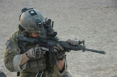 A Ranger from C Company, Battalion, Ranger Regiment scans for enemy insurgents during a combat operation in Helmand Province, Afghanistan, July Military Guns, Military Love, Military Photos, Military Motivation, Us Army Rangers, 75th Ranger Regiment, M4 Carbine, Military Special Forces, Ares