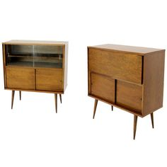 Pair of Mid-Century Modern Cabinet Bookcases | From a unique collection of antique and modern cabinets at https://www.1stdibs.com/furniture/storage-case-pieces/cabinets/