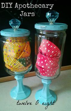 DIY Apothecary Jars; picture collections of these with candy, favor boxes and mini scoops as centerpieces on each reception table...cute, cheap, non-floral, double duty...covers a lot of bases!