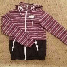 Nike rain jacket Tribal print water resistant jacket. Have matching leggings in closet. Worn handful of times Nike Jackets & Coats