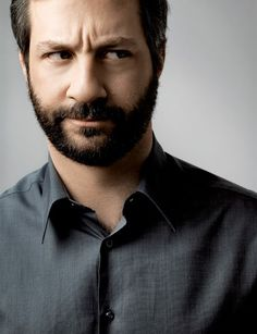 "JUDD APATOW isn't fooling us with that ""Aw Shucks, Who?......Me?"" routine he is so adept at. Producer-director-writer, doting husband (Leslie Mann) & father to Maude & Iris, Apatow is humorously self-effacing which belies his impeccably turned out appearance and grooming.  Which makes JUDD APATOW not one of the usual suspects. We salute him!"