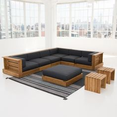 the coast collection is made of solid white oak with a teak oil finish and gray textured outdoor fabric