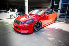 2006 Red Lexus GS430 with APR Performance wing on AirREX suspension and WedsSport SA-15R wheels