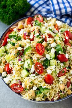 Greek orzo salad with pasta, cucumbers, tomatoes and feta cheese. Greek orzo salad with pasta, cucumbers, tomatoes and feta cheese. Tortellini, Penne, Orzo Salad Recipes, Salad Recipes For Dinner, Healthy Salad Recipes, Feta Cheese Recipes, Whole30 Recipes, Pasta Recipes, Baking Recipes