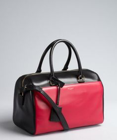 Saint Laurent : pink and black colorblock leather small duffel bag : style # 326303401