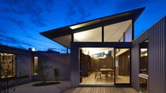 Arii Irie Architects uses angled windows and tilted roofs for Japanese house extension