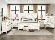 Lighten up your room with this Hancock Park king bed. Finished in a white, lightly distressed oak veneer, the raised panels with lamb's tongue details and deeply defined archway carvings add a country cottage charm to your bedroom. The high headboard and equally stately footboard add a beautiful foundation to make your bedding look its best every night. Enjoy this eye-catching bed on its own or surround it with other items from the Hancock Park collection (sold separately) for the ultimat...