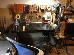 Here is Ronnie's other workbench where he tools leather.  The marble slab is a hard surface for making impressions and hammering designs into the leather.