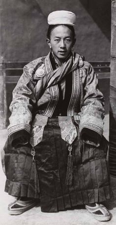 Lhawang Tobgyal Surkhang in ceremonial gyaluche dress as worn at New Year. Seated, with a textile-covered pillar next to February in: Tibet.Producer name-Made by: Hugh E Richardson (? Asian Photography, Landscape Photography, Portrait Photography, Travel Photography, Wedding Photography, Traditional Fashion, Traditional Dresses, Vintage Photographs, Vintage Photos