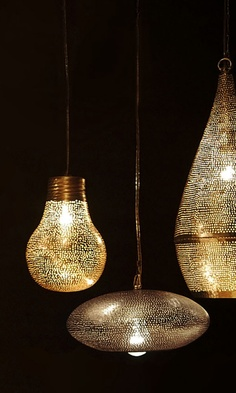 Zenza lamps.    One of them looks like a lightbulb. Funny how the notched pattern (I think I got that wrong) changes its identity.