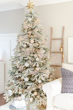 Christmas Tree Decorations 11237 A snowy flocked Christmas tree decorated in silver and rose gold adds a big dose of holiday cheer to this modern farmhouse living room White Christmas Trees, Christmas Tree Design, Beautiful Christmas Trees, Christmas Tree Themes, Noel Christmas, Rustic Christmas, Flocked Christmas Trees Decorated, Christmas Ideas, Simple Christmas