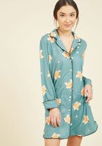 You may only be among the audience members at the aviary's new presentation, but all of the attention will be on you and your dotted top! Boasting a bevy of darling dots, this rich-blue, cap-sleeved top flutters in the wind like the wings of the beautiful animals that are on display.
