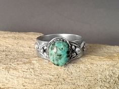This BoHo ring with an african turquoise stone and eye catching texture has a band made of sterling silver and details made of fine silver (.999). Fine silver makes it elegant, the turquoise and texture make it Boho - wear it with whatever you want and it will look good.