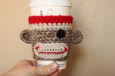 Sock Monkey Coffee Cozy: Crochet for your coffee cup! 10 free #crochet coffee sleeve patterns to make today! Great for gifts and keeping fingers safe! ♥