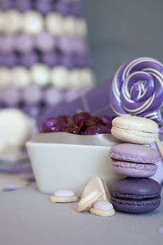 Macarons, lollipop, custom candy, and other sweets from a lilac, plum, and grey design.