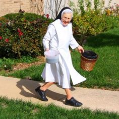 Sister Mary Samuella Volk, OP gardening native plants in Sacred Heart Convent at the end of the season.