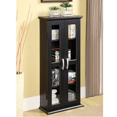 @Overstock - Elegance and function combine to give this contemporary wood DVD tower a striking appearanceDesign gives entertainment center a stylish modern lookTower will accommodate approximately 100 DVDs, Blu-ray discs or other mediahttp://www.overstock.com/Home-Garden/Wood-41-inch-Media-StorageTower/3482117/product.html?CID=214117 $98.99