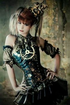 Steampunk fashion cutie. Love the pose, the embellishments of metals & clock work pieces & the jeweled Victorian colors