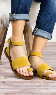 We are in LOVE with our new sandals from Free People. These have a toe strap with an adjustable wrap around the ankle. They are a flat sandal in taupe, but looks like a muted mustard. These will look