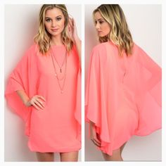 Neon pink batwing sleeve dress Sheer fabric batwing sleeves over double lined tank shift dress. Zips in the back. Medium fits 4/6 Dresses Mini