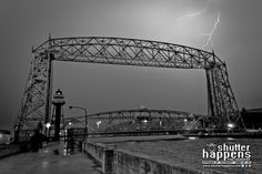 'Duluth Lift Bridge Under Lightning' by Mark David Zahn Photography (formerly Shutter Happens Photography).  Lightning lights up the sky during a severe thunderstorm, behind the Aerial Lift Bridge on Lake Superior, near Canal Park in Duluth Minnesota on May 26, 2012.