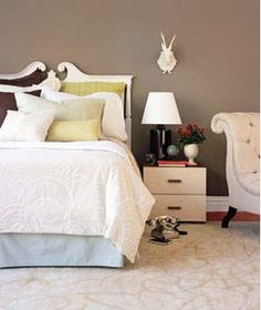 Bed, nightstand and chair on rug