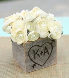 Centerpiece wooden boxes...i want to do this on the sweetheart table...the box...not the flowers